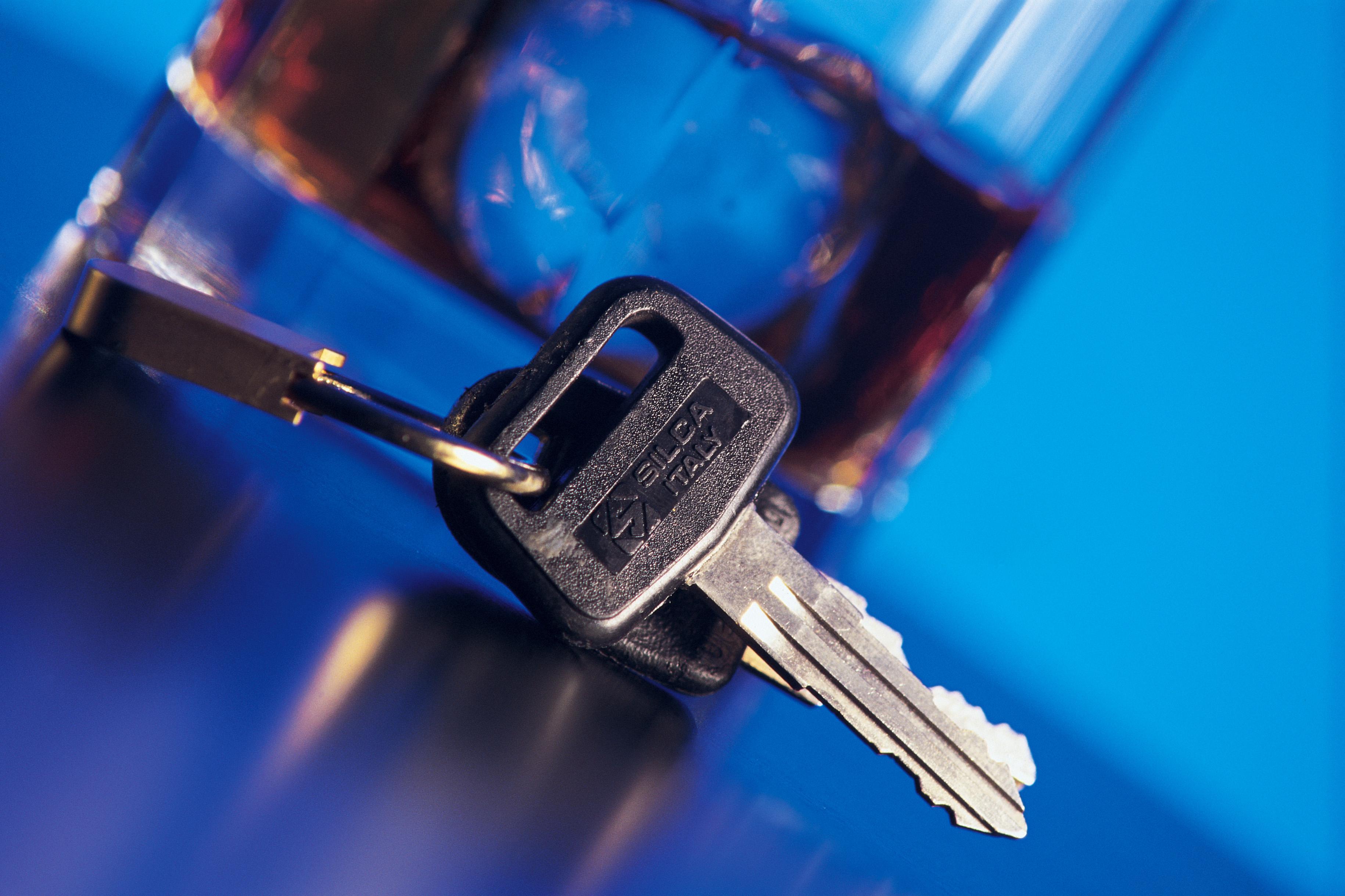 Car keys next to alcoholic beverage