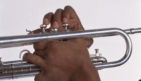 Young man's hands playing jazz trumpet, close-up