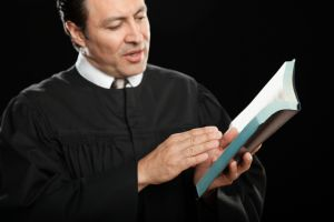 Hispanic pastor reading from Bible