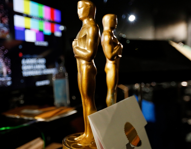 LOS ANGELES, CA - FEBRUARY 18, 2015: Two wooden stand-in Oscar statuettes are ready to be taken on