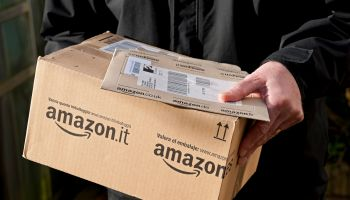 A Man Holding an Amazon Delivery