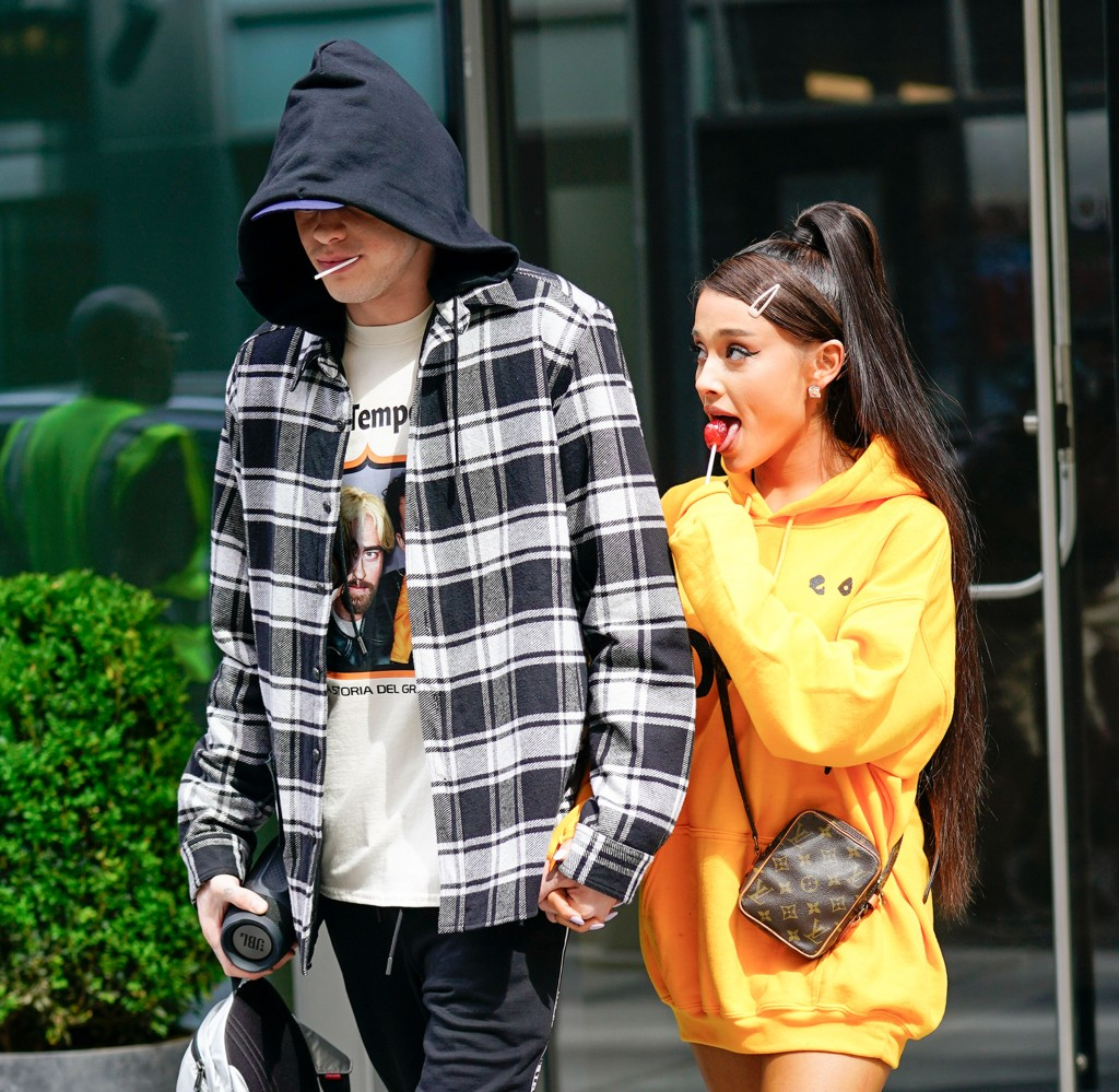 Ariana Grande and Pete Davidson mirror each other by sucking on lollipops and holding hands when out and about in New York