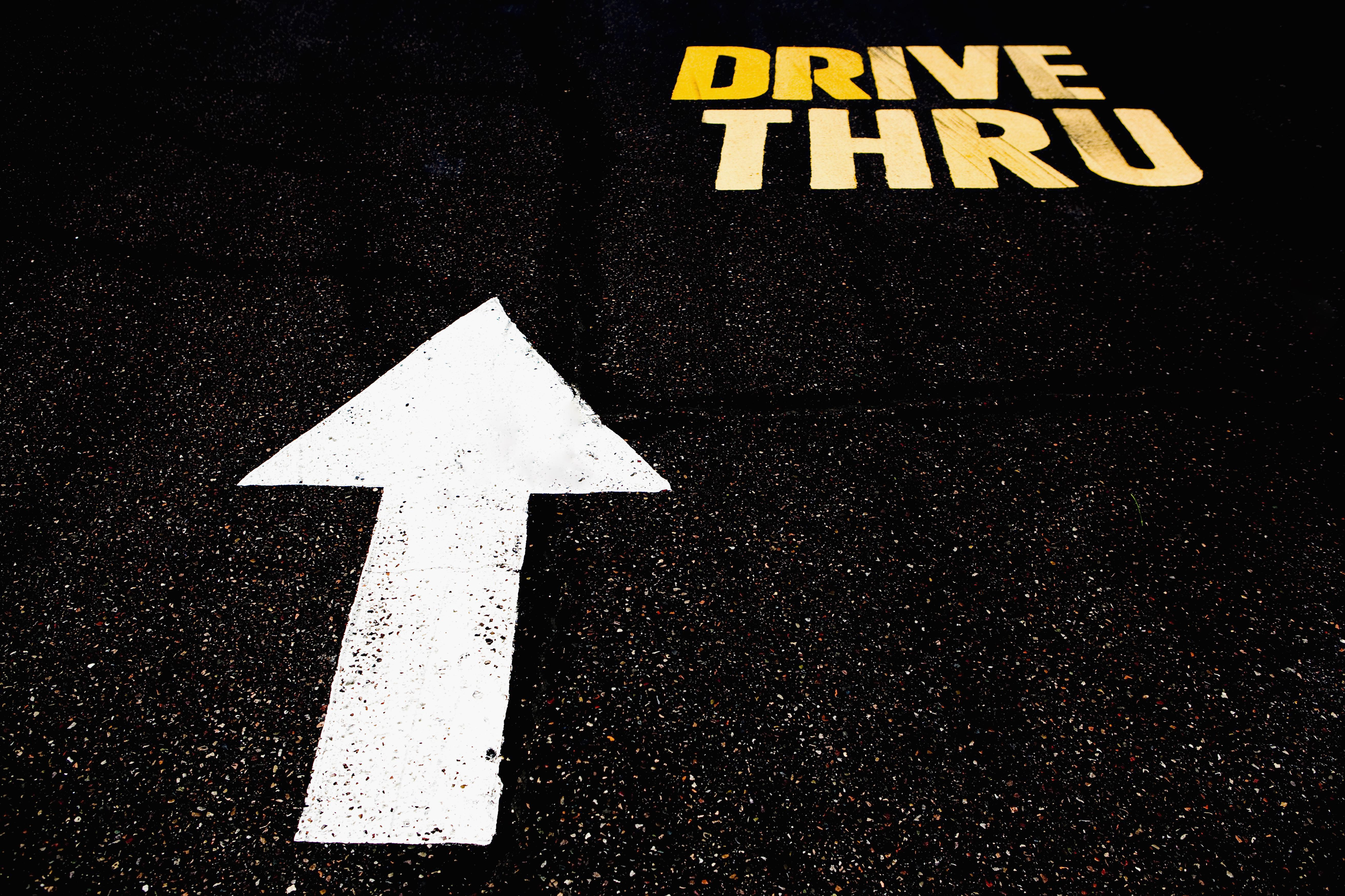 Drive Thru sign on the road