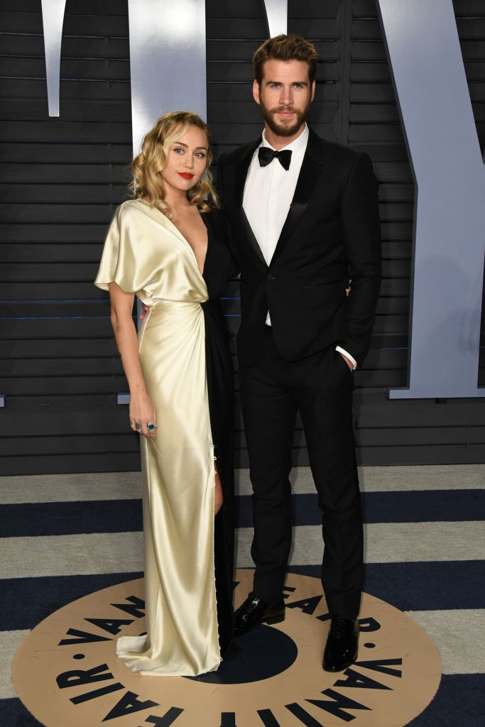 Miley Cyrus Wedding Dress.Miley Cyrus And Longtime Boyfriend Liam Hemsworth Wed Photos