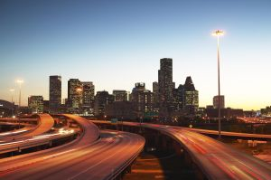 USA, Texas, Houston skyline, motorway, dusk (long exposure)