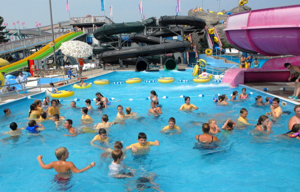 The pools were filled with swimmers at Splashtown USA Thursday. The park is adding two seven-story w...