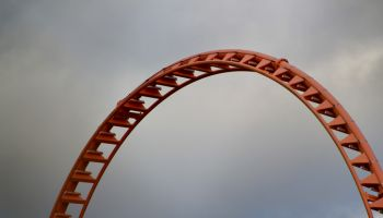Visual Building Blocks: Graphic Image of found patterns and shapes of a metal amusement park ride under an expansive sky