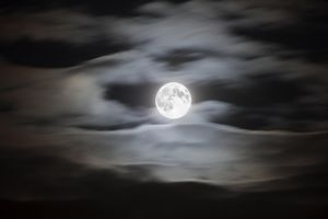 Full moon on a cloudy night sky