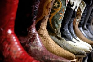 Row of cowboy boots in shoe store, full frame